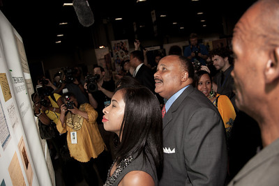 """Martin Luther King III and his wife Arndrea pause to  view the """"King Center Imaging Project , an initiative of JP Morgan Chase & Co."""