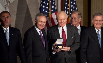 Senate Majority Leader Harry Reid (D-NV) (left) presents gold medal to John Glenn. Space legends John Glenn, Neil Armstrong, Buzz Aldrin and Michael Collins were awarded Congressional Gold Medals, the nation's highest civilian honor, on Wednesday, November 16, 2011. The ceremony was held in the US Capitol Rotunda in Washington DC.  (Photo by Jeff Malet)