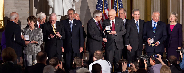 Space legends John Glenn, Neil Armstrong, Buzz Aldrin and Michael Collins were awarded Congressional Gold Medals, the nation's highest civilian honor, on Wednesday, November 16, 2011. The ceremony was held in the US Capitol Rotunda in Washington DC. In photo, left to right, Michael Collins, House Minority Leader Nancy Pelosi (D-CA), Neil Armstrong, Speaker John Boehner (R-OH), Sen. Harry Reid (D-NV), John Glenn, Sen. Mitch McConnell (R-KY), Buzz Aldrin, Sen. Kay Bailey Hutchison (R-TX) (Photo by Jeff Malet)