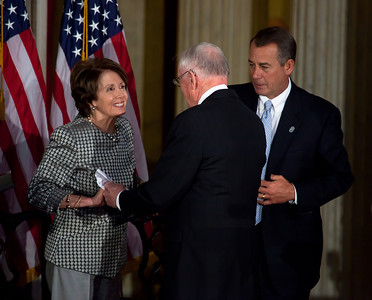 The first man to walk on the moon, Apollo astronaut Neil Armstrong is congratulated by House Minority Leader Nancy Pelosi (D-CA) and Speaker John Boehner (R-OH) during the ceremony where space legends Armstrong, John Glenn, Buzz Aldrin and Michael Collins were awarded Congressional Gold Medals, the nation's highest civilian honor, on Wednesday, November 16, 2011. The ceremony was held in the US Capitol Rotunda in Washington DC.(Photo by Jeff Malet)