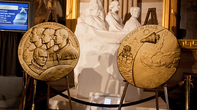 Space legends John Glenn, Neil Armstrong, Buzz Aldrin and Michael Collins were awarded Congressional Gold Medals (pictured here in enlargements), the nation's highest civilian honor, on Wednesday, November 16, 2011. The ceremony was held in the US Capitol Rotunda in Washington DC.  (Photo by Jeff Malet)