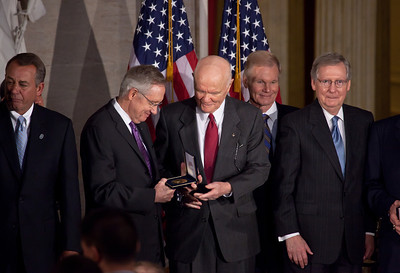 Senate Majority Leader Harry Reid (D-NV) (left) presents gold medal to John Glenn. Space legends John Glenn, Neil Armstrong, Buzz Aldrin and Michael Collins were awarded Congressional Gold Medals, the nation's highest civilian honor, on Wednesday, November 16, 2011. The ceremony was held in the US Capitol Rotunda in Washington DC. In background, Speaker John Boehner (R-OH), Sen. Bill Nelson (R-FL), Senate Minority Leader Mitch McConnell (R-KY). (Photo by Jeff Malet)