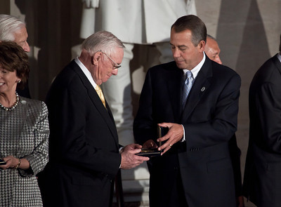 House Speaker John Boehner (R-OH) (on right) presents gold medal to Apollo astronaut Neil Armstrong (left). Space legends John Glenn, Neil Armstrong, Buzz Aldrin and Michael Collins were awarded Congressional Gold Medals, the nation's highest civilian honor, on Wednesday, November 16, 2011. The ceremony was held in the US Capitol Rotunda in Washington DC. (Photo by Jeff Malet)