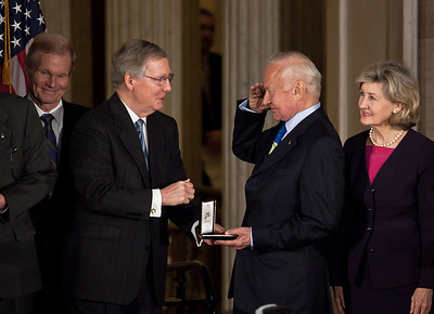 Senate Minority Leader Mitch McConnell (R-KY) (on left in photo) presents gold medal to famous Apollo astronaut Buzz Aldrin. Senators Bill Nelson (D-FL) and Kay Bailey Hutchison (R-TX) look on. Space legends John Glenn, Neil Armstrong, Buzz Aldrin and Michael Collins were awarded Congressional Gold Medals, the nation's highest civilian honor, on Wednesday, November 16, 2011. The ceremony was held in the US Capitol Rotunda in Washington DC. (Photo by Jeff Malet)