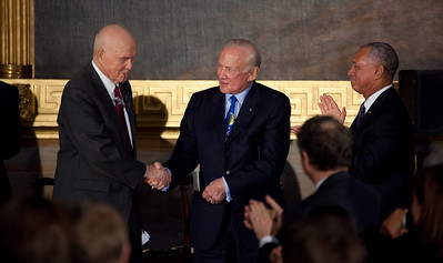 The first American to orbit the Earth, former Senator John Glenn (D-OH) is congratulated after delivering his acceptance speech by Apollo astronaut Buzz Aldrin and NASA Administrator Charles Bolden Jr. during the ceremony where space legends Neil Armstrong, John Glenn, Buzz Aldrin and Michael Collins were awarded Congressional Gold Medals, the nation's highest civilian honor, on Wednesday, November 16, 2011. The ceremony was held in the US Capitol Rotunda in Washington DC. (Photo by Jeff Malet)