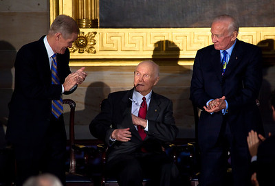 The first American to orbit the Earth, former Senator John Glenn (D-OH) (center in photo) is congratulated after delivering his acceptance speech by Senator Bill Nelson (D-FL) and Apollo astronaut Buzz Aldrin during the ceremony where space legends Neil Armstrong, John Glenn, Buzz Aldrin and Michael Collins were awarded Congressional Gold Medals, the nation's highest civilian honor, on Wednesday, November 16, 2011. The ceremony was held in the US Capitol Rotunda in Washington DC.  (Photo by Jeff Malet)