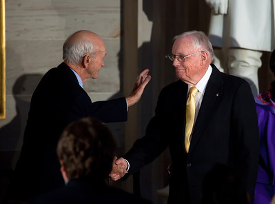 The first man to walk on the moon, Apollo astronaut Neil Armstrong (on right)is congratulated by fellow Apollo astronaut Michael Colliins afger delivering the acceptance speech during the ceremony where space legends Armstrong, John Glenn, Buzz Aldrin and Collins were awarded Congressional Gold Medals, the nation's highest civilian honor, on Wednesday, November 16, 2011. The ceremony was held in the US Capitol Rotunda in Washington DC. (Photo by Jeff Malet)