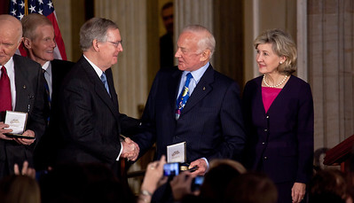 Senate Minority Leader Mitch McConnell (R-KY) (on left in photo) presents gold medal to famous Apollo astronaut Buzz Aldrin. Senators Bill Nelson (D-FL) and Kay Bailey Hutchison (R-TX) look on. Space legends John Glenn, Neil Armstrong, Buzz Aldrin and Michael Collins were awarded Congressional Gold Medals, the nation's highest civilian honor, on Wednesday, November 16, 2011. The ceremony was held in the US Capitol Rotunda in Washington DC. In left background, Senator Bill Nelson (D-FL). (Photo by Jeff Malet)