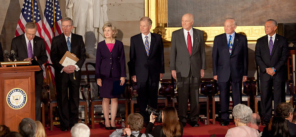 Space legends John Glenn, Neil Armstrong, Buzz Aldrin and Michael Collins were awarded Congressional Gold Medals, the nation's highest civilian honor, on Wednesday, November 16, 2011. The ceremony was held in the US Capitol Rotunda in Washington DC. In photo (left to right), Sen. Harry Reid (D-NV), Sen. Mitch McConnell (R-KY), Sen. Kay Bailey Hutchison (R-TX), Sen. Bill Nelson (D-FL), John Glenn, Buzz Aldrin, Charles Bolden, Jr. (NASA Administrator). (Photo by Jeff Malet)