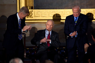 The first American to orbit the Earth, former Senator John Glenn (D-OH) is congratulated after delivering his acceptance speech by Senator Bill Nelson (D-FL) and Apollo astronaut Buzz Aldrin during the ceremony where space legends Neil Armstrong, John Glenn, Buzz Aldrin and Michael Collins were awarded Congressional Gold Medals, the nation's highest civilian honor, on Wednesday, November 16, 2011. The ceremony was held in the US Capitol Rotunda in Washington DC. (Photo by Jeff Malet)