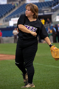 Linda Sanchez (D-CA) warms up. Sanchez, the only woman on either squad wears her signiture No. IX jersey in honor of Title IX legislation  which she says  helped propel woman's sports. (Photo by Jeff Malet)