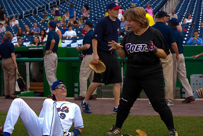 Rep. Linda Sanchez (D-CA) warming up with Rep. Anthony Weiner (D-NY). Sanchez, the only woman on either squad wears her signiture No. IX jersey that she wears  in honor of Title IX legislation  which she says  helped propel woman's sports. (Photo by Jeff Malet)