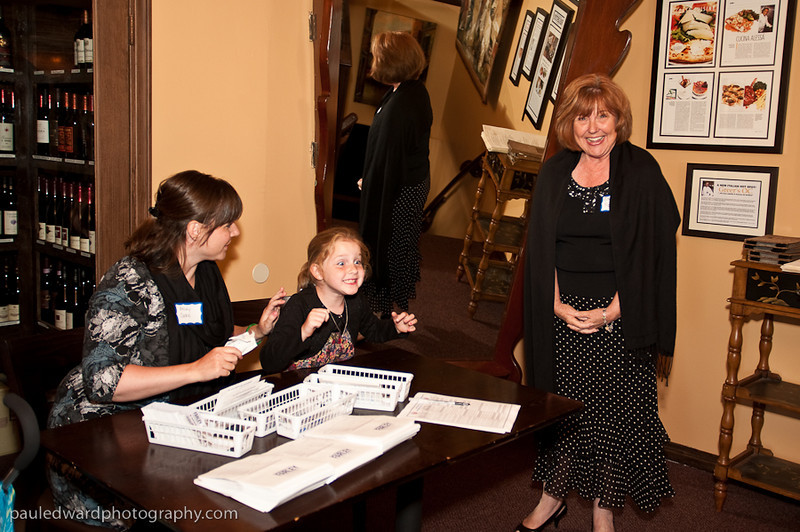 My daughter Sally being silly at the welcome table while Grandma Sharon & Aunt Becky look on. My family is a huge support!