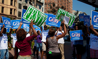 DC Mayor Adrian Fenty and Council Chairman Vincent Gray are about to debate, two weeks before their crucial September 14 Democratic primary. Here supporters of both candidates rally in front of the Newseum. The debate was held at the Newseum's Walter and Leonore Annenberg Theater in Washington DC on September 1, 2010.  Among the topics discussed were unemployment, public safety and schools. (Photo by Jeff Malet)