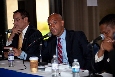 DC Mayor Adrian Fenty (seated in the center) and Vincent Gray (left)  begin their final debate, just days before their crucial September14 Democratic primary for DC mayor. The debate was held at at Tony and Joe's Seafood Place on Washington Harbor in the Georgetown section of Washington DC on September 10, 2010. Also participating is a third mayoral candidate Leo Alexander seated on the right. Carol Joynt was the moderator. (Photo by Jeff Malet)