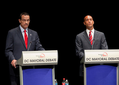 DC Mayor Adrian Fenty (right) and Council Chairman Vincent Gray (left) debate two weeks before their crucial September 14 Democratic primary. The debate was held at The Newseum's Walter and Leonore Annenberg Theater in Washington DC on September 1, 2010.  Among the topics discussed were unemployment, public safety and schools. (Photo by Jeff Malet)