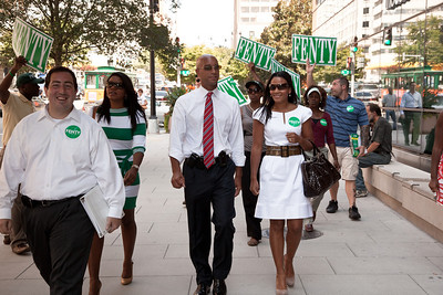 DC Mayor Adrian Fenty is accompanied by wife Michelle Fenty just outside the Newseum on 6th Street near Pennsylvania Ave. NW in Washington DC on September 1, 2010 where he will debate with Council Chairman Vincent Gray. Behind in most polls, the midday forum was one of Fenty's last opportunities to connect with large numbers of voters before the Sept. 14 Democratic primary.