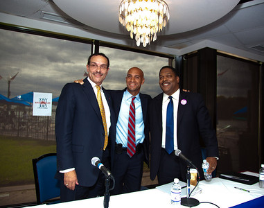 DC Mayor Adrian Fenty (center) and Vincent Gray (left) have just completed their final debate, just days before their crucial September14 Democratic primary for DC mayor. The debate was held at at Tony and Joe's Seafood Place on Washington Harbor in the Georgetown section of Washington DC on September 10, 2010. Also participating was a third mayoral candidate Leo Alexander (right). (Photo by Jeff Malet)