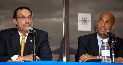 DC Mayor Adrian Fenty (right) and Vincent Gray (left)  begin their final debate, just days before their crucial September14 Democratic primary for DC mayor. The debate was held at at Tony and Joe's Seafood Place on Washington Harbor in the Georgetown section of Washington DC on September 10, 2010. Also participating is a third mayoral candidate Leo Alexander. (Photo by Jeff Malet)
