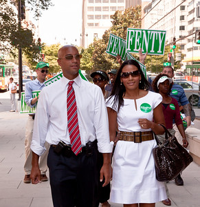 DC Mayor Adrian Fenty is accompanied by wife Michelle Fenty just outside the Newseum on 6th Street near Pennsylvania Ave. NW in Washington DC on September 1, 2010 where he will debate with Council Chairman Vincent Gray. Behind in most polls, the midday forum was one of Fenty's last opportunities to connect with large numbers of voters before the Sept. 14 Democratic primary. (Photo by Jeff Malet)