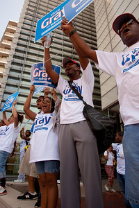 DC mayoral candidate Council Chairman Vincent Gray supporters Aaron Quarles and John Joseph rally at the Newseum.  Mayor Adrian Fenty and Vincent Gray are about to debate, two weeks before their crucial September 14 Democratic primary. The debate was held at The Newseum's Walter and Leonore Annenberg Theater in Washington DC on September 1, 2010.  Among the topics discussed were unemployment, public safety and schools. (Photo by Jeff Malet)