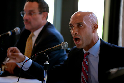 DC Mayor Adrian Fenty (speaking foreground ) and Vincent Gray conduct their final debate, just days before their crucial September14 Democratic primary for DC mayor. The debate was held at at Tony and Joe's Seafood Place on Washington Harbor in the Georgetown section of Washington DC on September 10, 2010. Also participating was a third mayoral candidate Leo Alexander. (Photo by Jeff Malet)