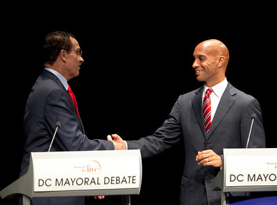 DC Mayor Adrian Fenty (right) and Council Chairman Vincent Gray (left) shake hands after their debate two weeks before their crucial September 14 Democratic primary. The debate was held at The Newseum in Washington DC on September 1, 2010.  Among the topics discussed were unemployment, public safety and schools. (Photo by Jeff Malet)