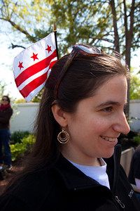 Taxation Without Representation once again is the slogan. In photo, Abby Levine, Program & Development Manager of DC Vote, wearing the DC Flag. DC shadow Senator Michael Brown was one of three arrested in an act of civil disobedience during a protest outside the Hart Senate Office Building on Capitol Hill in Washington DC on April 15, 2011. Brown joined a youth day Tax Protest targeting Senate Majority Leader Harry Reid (D-NV) who earlier in a budget deal with Republicans put restrictions on the District's ability to fund abortions providers. Also participating in the protest were DC Vote, an educational and advocacy organization dedicated to securing full voting representation in Congress and full democracy for the residents of the District of Columbia. The flag of the District of Columbia consists of three red stars above two red bars on a white background. It is based on the design of the coat of arms of George Washington. (Photo by Jeff Malet)