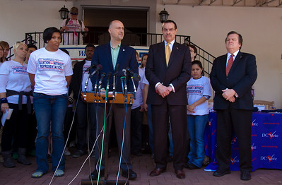 Taxation Without Representation once again is the slogan. In photo, left to right, Corryn Freeman, Sr at Howard University; Ilir Zherka, Executive Director of DC Vote; DC Mayor Vincent Gray; DC shadow Sen. Michael Brown. DC shadow Senator Michael Brown was one of three arrested in an act of civil disobedience during a protest outside the Hart Senate Office Building on Capitol Hill in Washington DC on April 15, 2011. Brown joined a youth day Tax Protest targeting Senate Majority Leader Harry Reid (D-NV) who earlier in a budget deal with Republicans put restrictions on the District's ability to fund abortions providers. Also participating in the protest were DC Vote, an educational and advocacy organization dedicated to securing full voting representation in Congress and full democracy for the residents of the District of Columbia. DC Mayor Vincent Gray, who had been arrested at a similar protest earlier in the week, spoke to the group. (Photo by Jeff Malet)