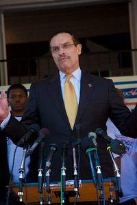 Taxation Without Representation once again is the slogan. In photo, DC Mayor Vincent Gray. DC shadow Senator Michael Brown was one of three arrested in an act of civil disobedience during a protest outside the Hart Senate Office Building on Capitol Hill in Washington DC on April 15, 2011. Brown joined a youth day Tax Protest targeting Senate Majority Leader Harry Reid (D-NV) who earlier in a budget deal with Republicans put restrictions on the District's ability to fund abortions providers. Also participating in the protest were DC Vote, an educational and advocacy organization dedicated to securing full voting representation in Congress and full democracy for the residents of the District of Columbia. DC Mayor Vincent Gray, pictured here, who had been arrested at a similar protest earlier in the week, spoke to the group. (Photo by Jeff Malet)