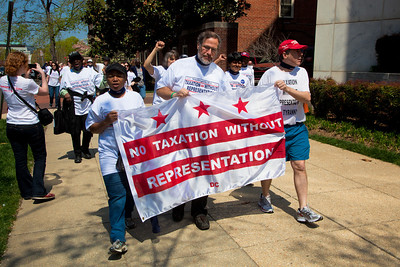 Taxation Without Representation once again is the slogan.  DC shadow Senator Michael Brown was one of three arrested in an act of civil disobedience during a protest outside the Hart Senate Office Building on Capitol Hill in Washington DC on April 15, 2011. Brown joined a youth day Tax Protest targeting Senate Majority Leader Harry Reid (D-NV) who earlier in a budget deal with Republicans put restrictions on the District's ability to fund abortions providers. Also participating in the protest were DC Vote, an educational and advocacy organization dedicated to securing full voting representation in Congress and full democracy for the residents of the District of Columbia. The flag of the District of Columbia consists of three red stars above two red bars on a white background. It is based on the design of the coat of arms of George Washington. (Photo by Jeff Malet)