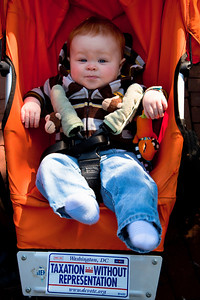 Washington DC resident Theodore Rietzke is only 7 months old but hopes to vote some day for representatives in Congress. DC shadow Senator Michael Brown was one of three arrested in an act of civil disobedience during a protest outside the Hart Senate Office Building on Capitol Hill in Washington DC on April 15, 2011. Brown joined a youth day Tax Protest targeting Senate Majority Leader Harry Reid (D-NV) who earlier in a budget deal with Republicans put restrictions on the District's ability to fund abortions providers. Also participating in the protest were DC Vote, an educational and advocacy organization dedicated to securing full voting representation in Congress and full democracy for the residents of the District of Columbia. DC Mayor Vincent Gray, who had been arrested at a similar protest earlier in the week, spoke to the group. (Photo by Jeff Malet)
