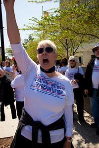 Taxation Without Representation once again is the slogan. Pictured here, DC Vote activists. DC shadow Senator Michael Brown was one of three arrested in an act of civil disobedience during a protest outside the Hart Senate Office Building on Capitol Hill in Washington DC on April 15, 2011. Brown joined a youth day Tax Protest targeting Senate Majority Leader Harry Reid (D-NV) who earlier in a budget deal with Republicans put restrictions on the District's ability to fund abortions providers. Also participating in the protest were DC Vote, an educational and advocacy organization dedicated to securing full voting representation in Congress and full democracy for the residents of the District of Columbia. (Photo by Jeff Malet)