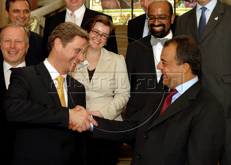 Germany's Foreign Affairs Minister Guido Westerwelle, right, shake hands with Rio de Janeiro Governor Sergio Cabral, left,  before a meeting at Laranjeiras Palace in Rio de Janeiro, Brazil,  March 12, 2010.  (Austral Foto/Renzo Gostoli)  NO ARCHIVE