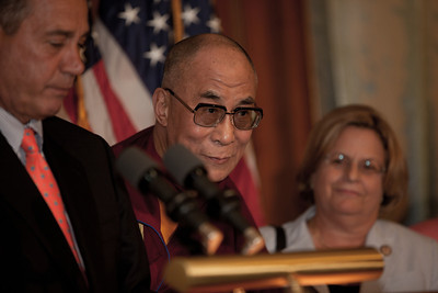 The Dalai Lama makes remarks on Capitol Hill in Washington DC, July 7, 2011, as he is warmly welcomed by House Speaker John Boehner (R-OH) (left), and House Minority Leader Nancy Pelosi (D-CA). The Dalai Lama met with several U.S. lawmakers in his first visit to the United States since he retired as the political leader of the Tibetan government in exile. Rep. Ileana Ros-Lehtinen (R-FL) on right in photo. (Photo by Jeff Malet)