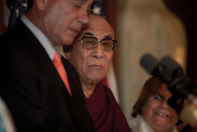 The Dalai Lama (center) made remarks on Capitol Hill in Washington DC, July 7, 2011, as he is warmly welcomed by House Speaker John Boehner (R-OH) (left in photo), and House Minority Leader Nancy Pelosi (D-CA). The Dalai Lama met with several U.S. lawmakers in his first visit to the United States since he retired as the political leader of the Tibetan government in exile.  (Photo by Jeff Malet)