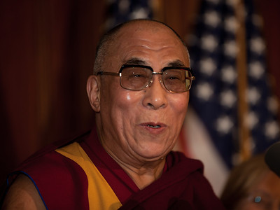 The Dalai Lama makes remarks on Capitol Hill in Washington DC, July 7, 2011, as he is warmly welcomed by House Speaker John Boehner (R-OH), and House Minority Leader Nancy Pelosi (D-CA). The Dalai Lama met with several U.S. lawmakers in his first visit to the United States since he retired as the political leader of the Tibetan government in exile. The Dalai Lama is in Washington to take part in an ancient Buddhist ritual and a call for world peace.  (Photo by Jeff Malet)