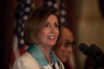 Nancy Pelosi says the Dalai Lama (rear in photo) is the voice of understanding. The Dalai Lama made remarks on Capitol Hill in Washington DC, July 7, 2011, as he is warmly welcomed by House Speaker John Boehner (R-OH), and House Minority Leader Nancy Pelosi (D-CA). The Dalai Lama met with several U.S. lawmakers in his first visit to the United States since he retired as the political leader of the Tibetan government in exile.  (Photo by Jeff Malet)
