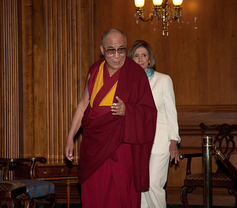 The Dalai Lama makes remarks on Capitol Hill in Washington DC, July 7, 2011, as he is warmly welcomed by House Speaker John Boehner (R-OH), and House Minority Leader Nancy Pelosi (D-CA) (behind Dalai Lama in photo). The Dalai Lama met with several U.S. lawmakers in his first visit to the United States since he retired as the political leader of the Tibetan government in exile.  (Photo by Jeff Malet)
