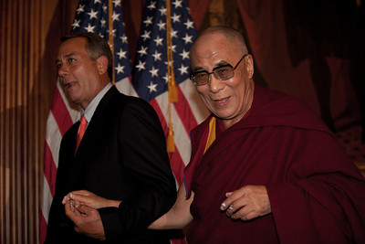 The Dalai Lama makes remarks on Capitol Hill in Washington DC, July 7, 2011, as he is warmly welcomed by House Speaker John Boehner (R-OH), and House Minority Leader Nancy Pelosi (D-CA). As the meeting ended, Boehner stumbled behind the podium as he directed the Dalai Lama out of the room. The Dalai Lama took Boehner's hand and the two exited the room arm-in-arm. The Dalai Lama met with several U.S. lawmakers in his first visit to the United States since he retired as the political leader of the Tibetan government in exile. The Dalai Lama is in Washington to take part in an ancient Buddhist ritual and a call for world peace. (Photo by Jeff Malet)
