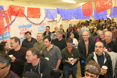 Supporter listening to the comments of comedian and supporter, Nato Green who served as the event's MC.  Saturday, March 29th, 2014, David Campos for State Assembly AD17 Campaign HQ, 3143 Mission Street, San Francisco.   http://www.davidcampossf.com https://www.facebook.com/davidcampossf
