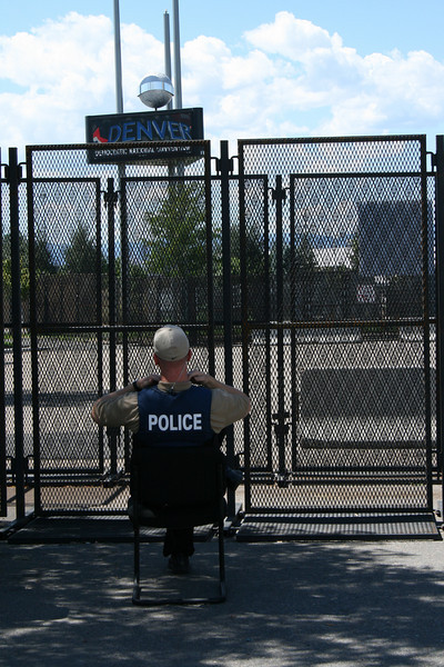 A Denver police officer gazes on an empty, but secure, expanse of fenced-off territory during the 2008 Democratic National Convention Tuesday, August 26, 2008. (Anne-Marie Taylor Lathrop)