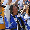Patsy Whitehorse, a Washington state delegate and member of the Yakima Indian Nation, waves to Sen. Barack Obama as he accepts the Democratic presidential nomination at Invesco Field during the Democratic National Convention in Denver, Thursday, August 28, 2008. (Anne-Marie Taylor Lathrop)