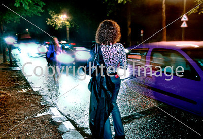 PARIS, France, Prostitutes in Bois de Boulogne park at night.  Transsexuals distributing tracts to protest government repression of prostitution,for clients.