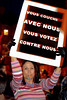 "PARIS, Nov. 5 - Prostitute at Demonstration in front of Senate Against Rightist Government Law Criminalizing prostitution.,(Law on Interior Security, or ""Sarkozy"" law) Sign reads, ""You Sleep with Us, You Vote Against Us"".© Tom Craig 2002"