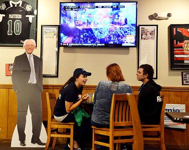 Dems share laughs between barbs watching debate