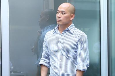 Thao Ngo listening to Dennis speak.