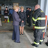 The Devens Fire Department got a grant for just over $200,000 for turn out gear and on Wednesday afternoon held a press conference about the grant with U.S. Rep. Niki Tsongas.  Firefighter Doug Hanks explains the new gear to Tsongas and President and CEO of MassDevelopment Marty Jones as he tries it on during the event. SENTINEL & ENTERPRISE/JOHN LOVE
