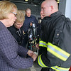 The Devens Fire Department got a grant for just over $200,000 for turn out gear and on Wednesday afternoon held a press conference about the grant with U.S. Rep. Niki Tsongas.  Firefighter Doug Hanks explains the two layers of the new jackets to Tsongas and President and CEO of MassDevelopment Marty Jones during the event. SENTINEL & ENTERPRISE/JOHN LOVE