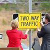 MassDevelopment announced on Tuesday a $1.85 million dollar investment for the the phase 4, the final phase, of Devens Jackson Road redevelopment project.  President & CEO of MassDevelopment Marty Jones and Matt Erskine Deputy Assistant Secretary of U.S. Commerce for Economic Development hang a two way  sign over the one way sign that will change that part of Jackson Road, during the event on Devens. SENTINEL & ENTERPRISE/JOHN LOVE